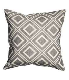 Cushion cover in jacquard-weave, cotton-blend fabric. Solid-color backing and concealed zip. Size 20 x 20 in.
