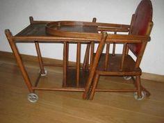 Kinderstoel.  Kon worden veranderd in tafel en stoeltje dat kon rijden.