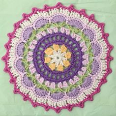 "Ali in Scotland made this beautiful springtime-inspired crochet mandala using Wink's Picots and Petals pattern. She writes, ""This was the first pattern of Wink's that I found and I was just blow ..."