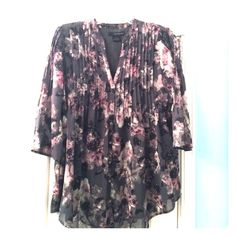 Calvin Klein Jeans grey floral blouse Great for work! This 3/4 sleeve blouse is a loose fitting button down with a floral pattern on it. Attached lining, 100% polyester, machine wash cold Calvin Klein Tops Blouses
