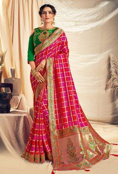 Pink Color Weaved Silk Georgette Checks Design Saree Product Details : Fabric of this designer saree is weaved silk georgette. Saree color is pink. Comes along with a green raw silk unstitched blouse. Saree has thread, zari and cord embroidery, bana Art Silk Sarees, Silk Sarees Online, Georgette Sarees, Look Festival, Checks Saree, Party Kleidung, Latest Designer Sarees, Traditional Fashion, Party Wear Sarees