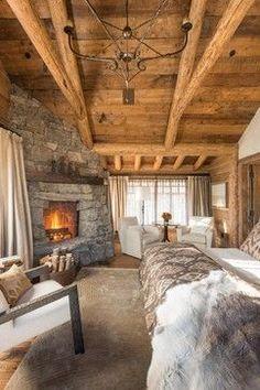 Cozy Rustic Bedroom. Love those log beams.