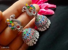 Earrings & Studs Attractive Oxidized Women's Earrings Base Metal: Alloy Type: Jhumkhas Multipack: 1 Country of Origin: India Sizes Available: Free Size   Catalog Rating: ★4.4 (14791)  Catalog Name: Arya Attractive Alloy Women's Earrings Vol 15 CatalogID_534680 C77-SC1091 Code: 061-3811273-792