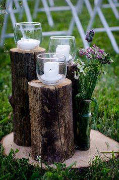ignore the style of candles - but I really like the tree stump idea for the unity candles to sit on