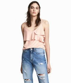 Powder pink. Camisole top in thick jersey with a slight sheen. Narrow adjustable shoulder straps and ruffles at neckline.