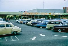 TacomaWA1950s_1000  1. Look at all the colors--on the cars and the building! 2. Love the art deco look of that time period.