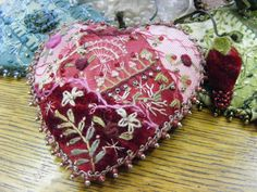 This pin cushion is so beautiful with the exquisite variety of embroidery stitches, french knots and lovely beaded crochet edge.