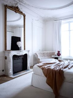absolutely gorgeous mirror, fireplace, and detailed moldings