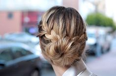 Just add cute braids to update a classic bun