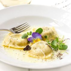 Tender homemade ravioli filled with sautéed mushrooms and onions mixed with creamy goat cheese, ricotta and fresh fragrant rosemary.
