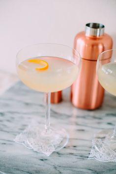 The Orange Cosmo 3 parts orange vodka 1 part orange liquor 1 part white cranberry juice Squeeze of fresh orange juice Orange peel to garnish
