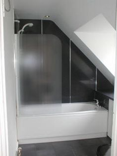 Loft bathroom tucked in corner under the window