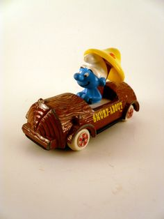 | Cute 1980s Ertl Co. Smurf-About Smurf Tree Log Car