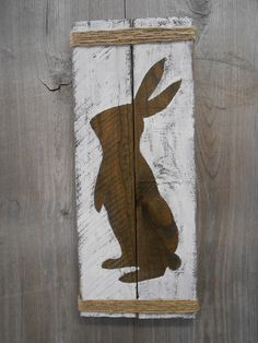 Rustic Easter Bunny on reclaimed wood by WhisperwingDesigns on Etsy https://www.etsy.com/listing/266380082/rustic-easter-bunny-on-reclaimed-wood