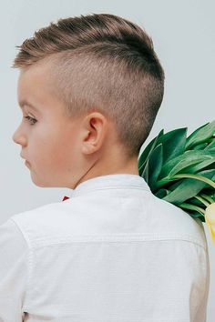 Little boy haircuts can be as trendy and stylish as adult ones. Choose a simple yet cool hairstyle for your toddler, be it a short on sides long on top cut, a black curly faux hawk with a fade or a longer Mohawk. #menshaircuts #menshairstyles #boyshaircuts #littleboyhaircuts #todlerboy #boyshair #todlerboyhair Stylish Boy Haircuts, Boy Haircuts Short, Little Boy Hairstyles, Toddler Boy Haircuts, Short Mens Hairstyles Fade, Boys Haircut Styles, Textured Haircut, Faded Hair, Long Hair Cuts