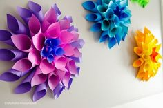 DIY Paper Dahlias - Why buy fresh flowers for decorations when you can just make your own paper flowers instead? Here we have colorful paper dahlias which are very good wall decorations. There are plenty of tutorials online waiting for you.