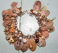 Flattened penny bracelet. I am so making this I have all the pennies from my childhood at Disney!!