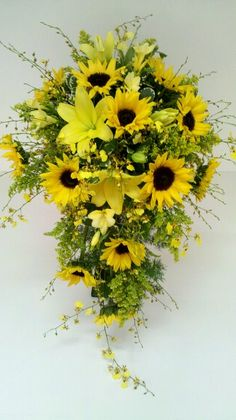 A cascade bridal with oncidium orchids, sunflowers and lilies!