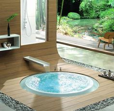 In ground bathtub. Outdoor bathroom.