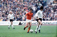 Holland's Johan Cruyff runs at West Germany's Franz Beckenbauer during the 1974 World Cup final