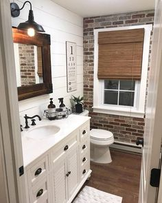 Old Mill Brick Single Thin Brick Flats are made from the highest quality geniune kiln fired clay brick. Single Thin Brick is designed for quick and easy do-it-yourself installation. Castle Gate is a distinctive blend of reds, grays and blacks, tumbled for Brick Veneer Wall, Design Rustique, Thin Brick, Barn Lighting, Lighting Ideas, Bathroom Interior, White Bathroom, Bathroom Ideas, Ikea Bathroom