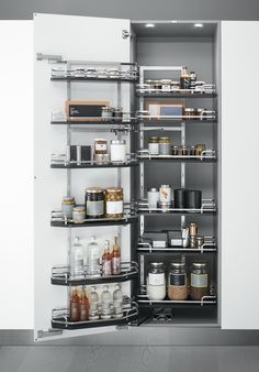 Accessorised pantry unit, pantry unit with accessories and 1 or 2 doors with 170° opening. 6-12 baskets in elliptic cross-section wire with black..