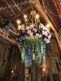 Rustic Barn Wedding; flower chandelier; hanging flowers; flowers hanging in a barn; reception flowers; pink roses; blush roses; red roses; white larkspur; blue delphinium; baby's breath Lisa Foster Floral Design www.lisafosterdesign.com