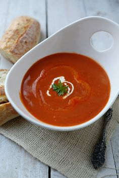 roasted red pepper soup: red peppers, olive oil, onion, garlic, parsley, bay leaves, chicken stock, S&P, cream for garnish