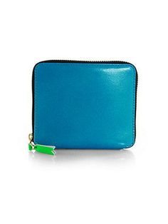 Commes des Garcons wallet in the best blue from Saks.