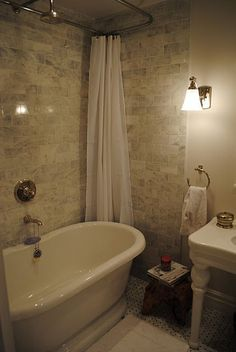 I love this!!! You get the best of both worlds...a vintage inspired soak tub and a shower without it looking like a shower combo if you know what I mean!!!! Talk about relaxation!!!