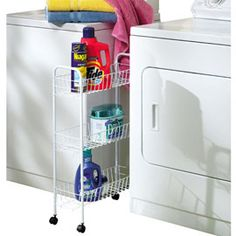 """Declutter your laundry room and keep products in easy reach with this Three Tier Rolling Cart. Just 7"""" so it fits in between your washer and dryer! Solutions.com #Laundry #SpaceSaver"""