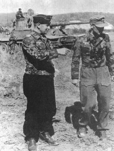 """Oberstleutnant Adelbert Schulz - commander of Pz.Rgt.27 of the 7`th Panzer Div - in coference with other staff officer , during exercise`s conducted with 3`th Swere Panser Abt. 503 . In the background is Tiger """" 300 """"-  the company commander's vehicle . June 1943"""