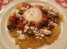 Safest Choice egg simmered in ratatouille served over spaghetti squash with feta cheese.