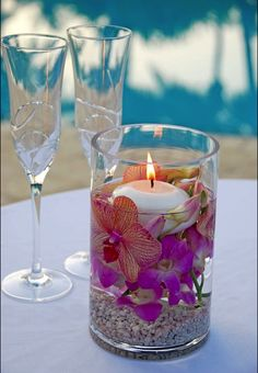 Underwater Orchids make unique Center Pieces for your Wedding Tables. Add a floating candle on top for romantic evening lighting and you have a customized accent for your guests to admire all evening. - Maybe instead of rocks... we could put sea glass or shells at the bottom.