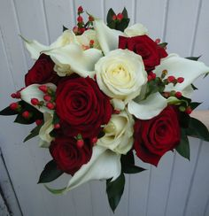 Crimson and creams, velvet texture Roses and calla's