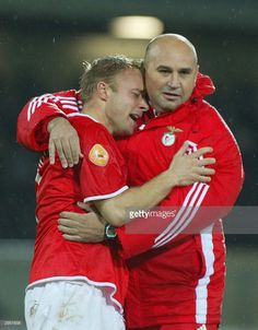 Benfica player Andersson (L) is comforted by an assistant coach after Benfica's Hungarian soccer striker Miklos Feher (down) during the Portuguese Premier League match held at Guimaraes stadium 25 January 2004. Hungarian striker Mikos Feher became the second international footballer in the last seven months to die during a game when he collapsed after being yellow-carded while playing for Benfica. The 24-year-old Feher, who had come on as a substitute after 60 minutes, was rushed to…