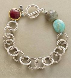 "Sky Link Bracelet by Nicole Ardis Jewelry featured in Sundance Catalog. Item No. 64353 $180.00 Apatite, labradorite and ruby mimic the sky, evening and sun light in this handcast sterling silver bracelet. Sterling silver toggle. Exclusive. 7-1/2""L. http://www.sundancecatalog.com"
