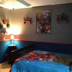 Avengers room decor -- Thomas would LOVE this although I'm sure those toys and masks would be on the floor more than on the walls lol