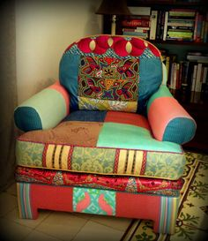 Re-upholstered chair. Love the bright colors and fabrics.