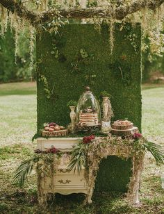 moss backdrop for a dessert table will strike
