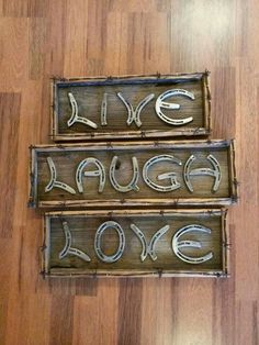 Sign made of horse shoes... Love this!