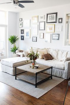 Great gallery wall - comfy living room. Megan Koranda's Chicago Home Tour #theeverygirl
