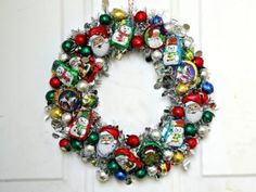 Now why didn't I think of that? Transform foil-wrapped Christmas candies into a pretty ornament-inspired Christmas wreath, using a few supplies from the dollar store.