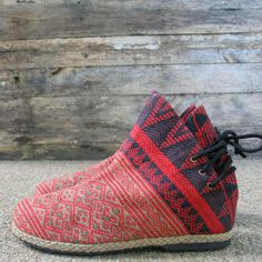 A fun and funky ethnic Naga embroidered women's ankle boot. One of a kind ethnic footwear.AmberHandmadeEmbroidered cotton uppersCotton lining6.5/16.5 cm front boot shaft 6/15.2 cm lace up back boot shaftPatterns placement variesCreated with re-pur...