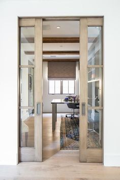 Glass pocket doors leading into small workspace | Stand Architects