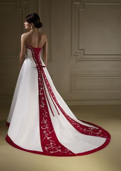 A little to flashy, but I like the clingyness of the gown and how it trails. Too bright a red for the color, but the needlework is beautiful. Not sure how I feel about the tie up lace in the back though.
