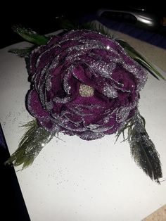 made from purple organza ,and feathers