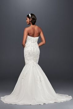 A hint of metallic gleam radiates from the beaded lace appliques and 3D flowers that adorn this form-fitting trumpet wedding gown.  Jewel, exclusively at David\'s Bridal  Polyester  Sweep train  Back