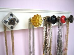 A great way to hang up necklaces or bags. And i love the vintage door handles!