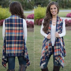 Wrap up in this checkered plaid vest with gorgeous waterfall front details. The detail doesn't stop there though, it continues with a soft navy faux suede fabric all around the seams.
